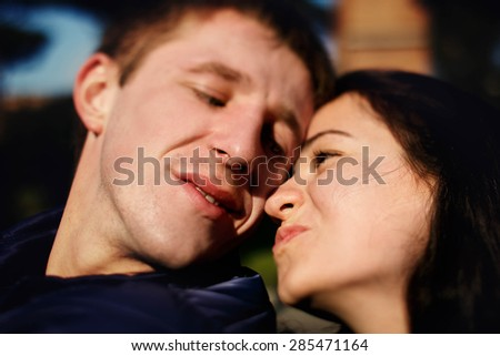 beautiful young girl with boyfriend have a good time in sunny green park of Rome