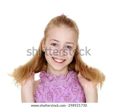 Beautiful young girl with bright lush straightens hair hands hair, close-up-Isolated on white background - stock photo