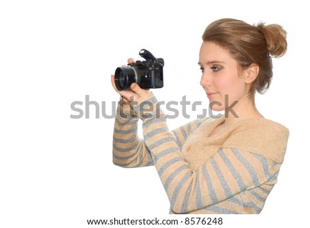 Beautiful young girl with camera isolated over a white background - stock photo