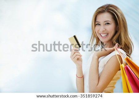 Beautiful young girl with credit card - stock photo