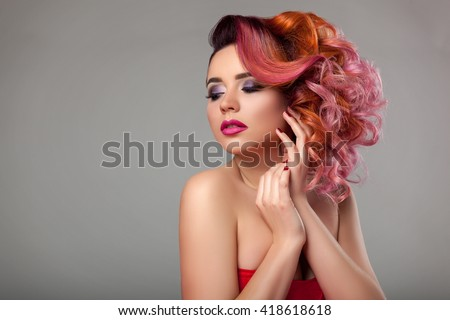 Beautiful young girl with curly hair. - stock photo