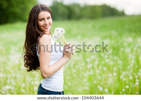 beautiful young girl with dandelion - stock photo