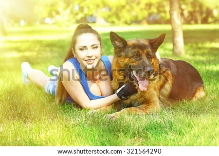 Beautiful young girl with dog in park - stock photo