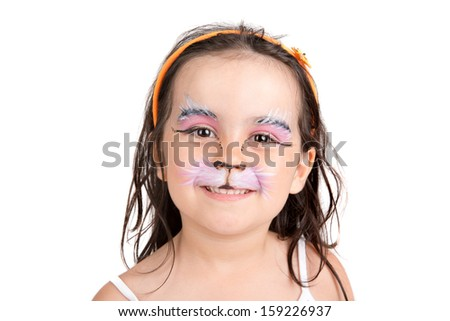 Beautiful young girl with face painted like a kitten