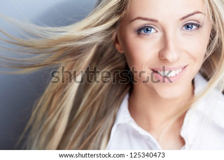 Beautiful young girl with flying hair