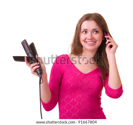 Beautiful young girl with hair dryer and telephone on white background.