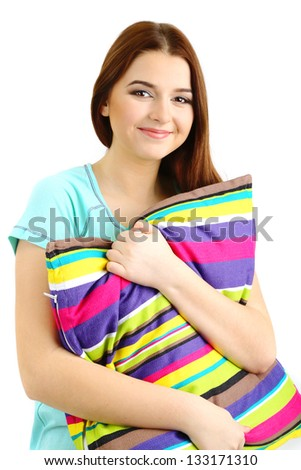 Beautiful young girl with pillow isolated on white