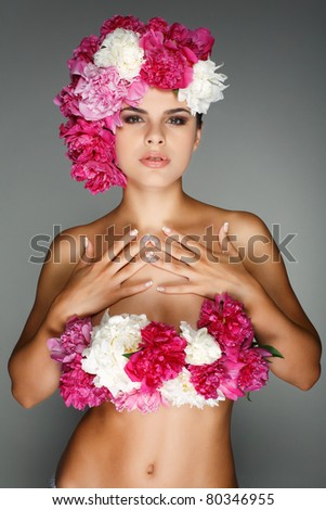 beautiful young girl with pink flowers - stock photo