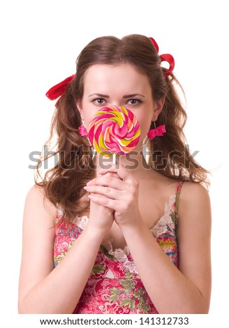 Beautiful young girl with pink spiral lollipops on white background.