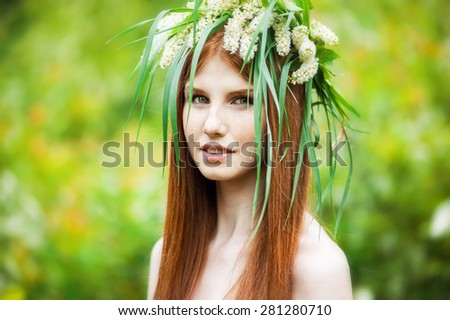 Beautiful young girl with red hair in wreath - stock photo