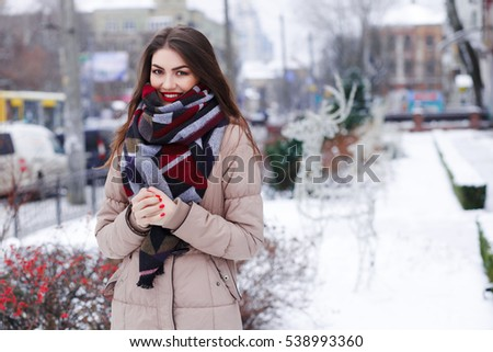 beautiful young girl with red lips smiling outdoors in winter