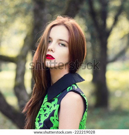 beautiful young girl with sexy red lips. photos in warm colors on a sunny day - stock photo