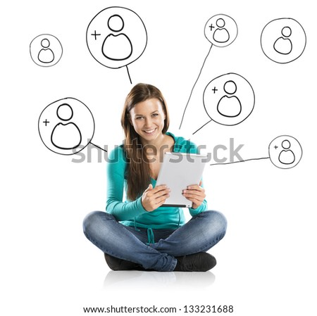 Beautiful young girl with tablet is using social media - stock photo