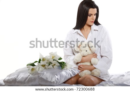 beautiful young girl with tulips and soft toy - stock photo