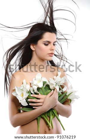 beautiful young girl with tulips,isolated on a white background - stock photo