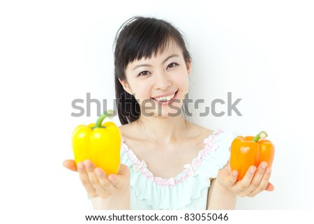 beautiful young girl with two peppers
