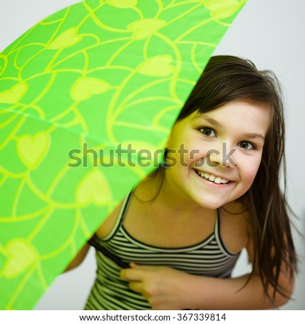 Beautiful young girl with umbrella - stock photo
