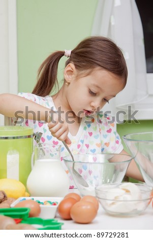 Beautiful young Girl Working in the Kitchen baking - stock photo