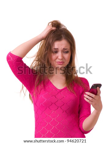 Beautiful young girl worrying with telephone on white background.
