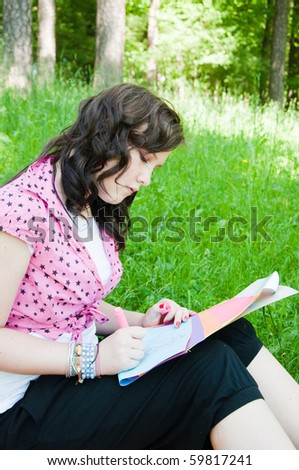 beautiful Young Girl Writing Outdoor - stock photo