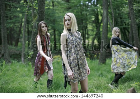 beautiful young girls posing in the green woods - stock photo