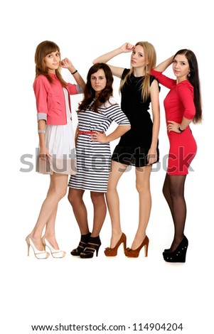 beautiful young girls posing on light background - stock photo
