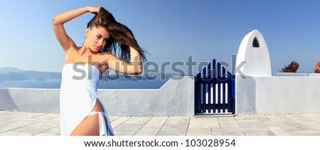 Beautiful young Greek woman  posing in Santorini - stock photo