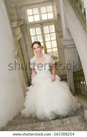 Beautiful young happy bride in a white and ivory wedding dress - stock photo