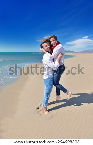beautiful young happy couple enjoying at sea - stock photo