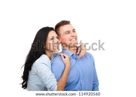 beautiful young happy couple love smiling embracing, man and woman smile look up to empty copy space, isolated over white background - stock photo