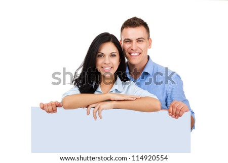 beautiful young happy couple love smiling embracing, man and woman smile standing hold blank board with empty copy space, looking at camera, isolated over white background
