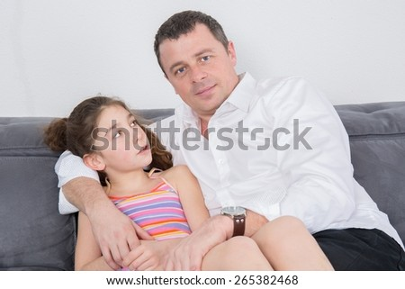 Beautiful young happy family with daughter - stock photo