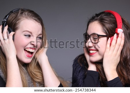 Beautiful young happy girlfriends - stock photo