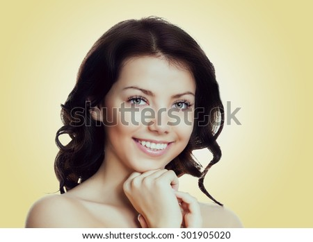 beautiful young happy woman against yellow background - stock photo
