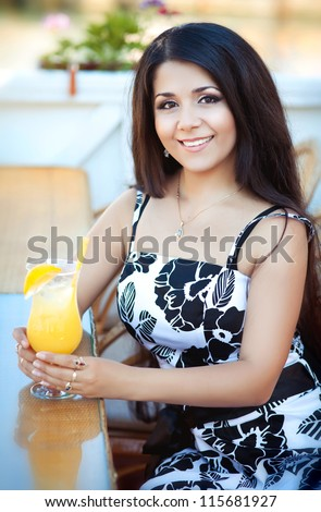 http://thumb1.shutterstock.com/display_pic_with_logo/913579/115681927/stock-photo-beautiful-young-happy-woman-in-cafe-with-fresh-orange-juice-stylish-sexy-lady-waiting-for-someone-115681927.jpg