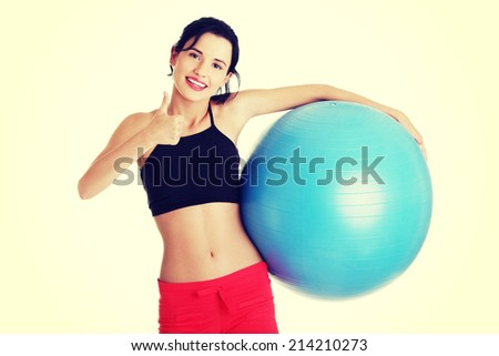 Beautiful young healthy lifestyle woman with pilates exercise ball.