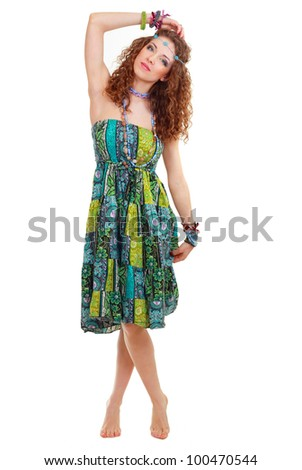 beautiful young hippie woman in hippie outfit green dress standing bootlessly in full-length isolated - stock photo