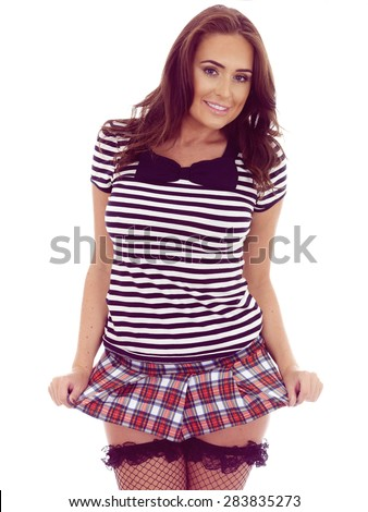 Beautiful Young Hispanic Woman Posing in a Very Short Mini Skirt Revealing Her Stocking Tops Against White