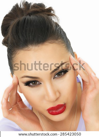 Beautiful Young Hispanic Woman Suffering With A headache and Feeling Unwell Shot Against A White Background