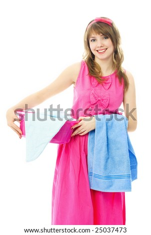 beautiful young housewife dressed in pink dress with a basin full of clothes