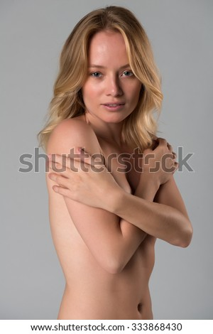 Beautiful young Hungarian blonde nude on gray - stock photo