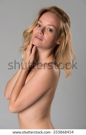 Beautiful young Hungarian blonde nude on gray