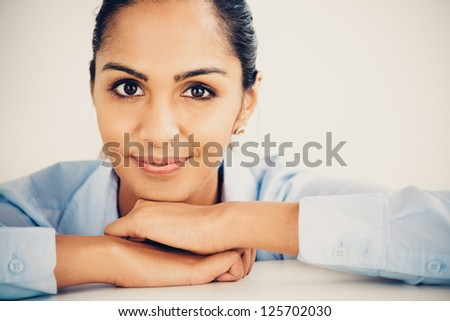 Beautiful young Indian business woman portrait happy smiling - stock photo