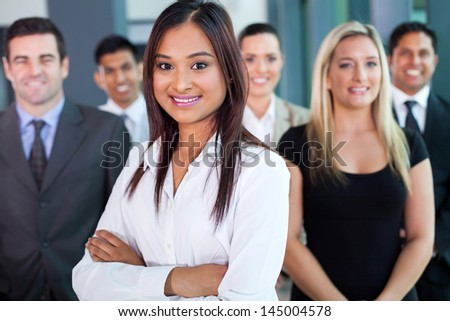 beautiful young indian businesswoman and team in office - stock photo