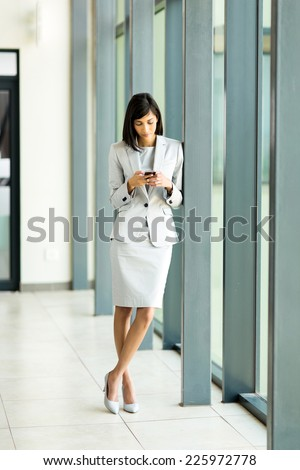 beautiful young indian career woman using cell phone - stock photo