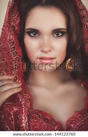 Beautiful young indian woman bellydancer n traditional clothing with bridal makeup and jewelry. gorgeous brunette bride traditionally dressed Outdoors in India. Girl bollywood dancer in Sari. Dancer - stock photo