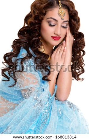 Beautiful young indian woman in traditional clothing with bridal makeup and jewelry.  - stock photo