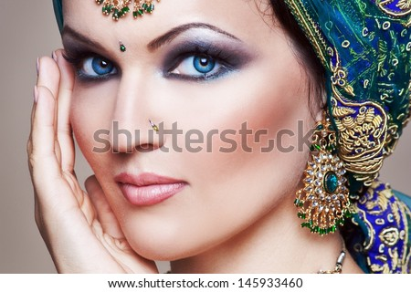 Beautiful young indian woman in traditional clothing with bridal makeup and jewelry. gorgeous brunette bride. Girl bollywood dancer in Sari. Arabian bellydancer  - stock photo