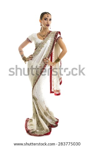 Beautiful Young Indian Woman in Traditional Clothing with Bridal Makeup and Oriental Jewelry. Beautiful Girl Bollywood dancer (Bellydancer) in Sari. Eastern fairy tale. White background - stock photo