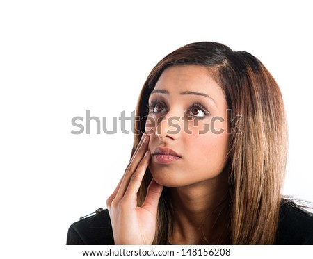 Beautiful young Indian woman thinking hard about something - stock photo